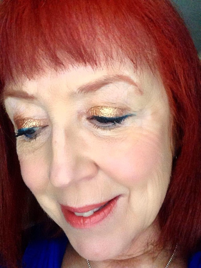 eye makeup with Lorac Unzipped Gold shadow palette and essence gel eyeliner in teal