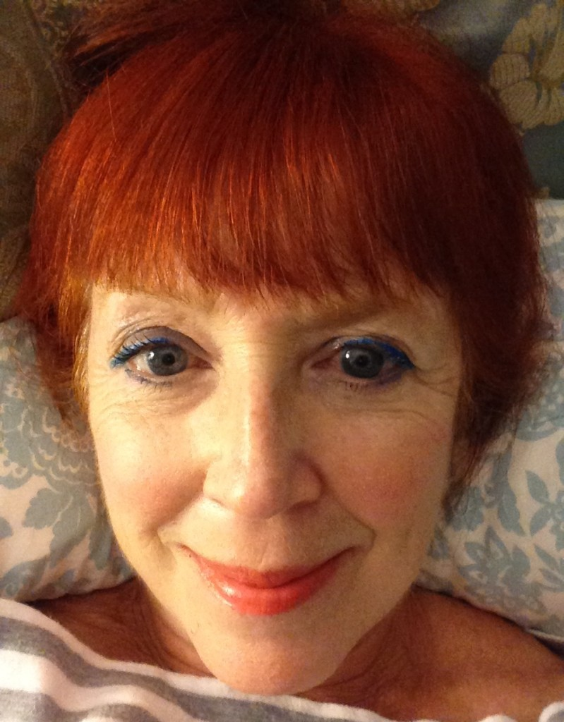 Face of the Day: blue eye makeup, tangerine blush and lipstick