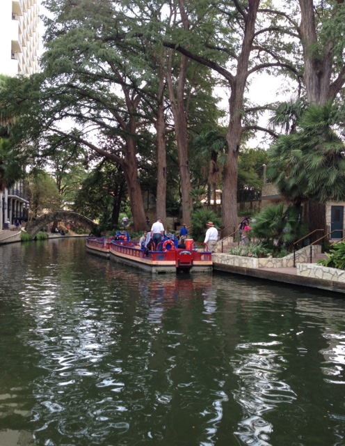 boat on the Riverwalk San Antonio. neversaydiebeauty.com @redAllison