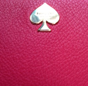 Kate Spade logo on red leather clutch wallet neversaydiebeauty.com @redAllison