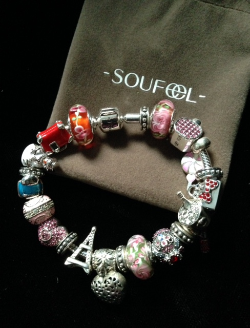 filled Soufeel charm bracelet on pouch
