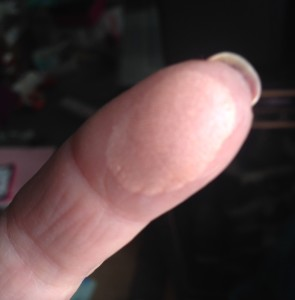 finger swatch of Cindy Lou Manizer Highlighter from theBalm neversaydiebeauty.com @redAllison
