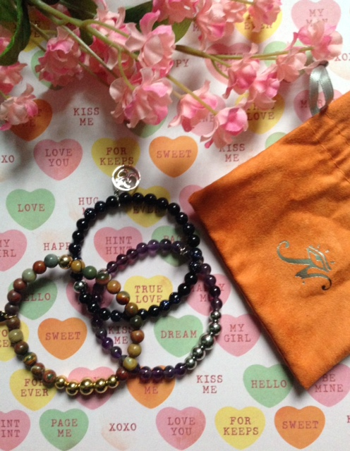 beaded Joseph Nogucci bracelets with orange suede drawstring bag neversaydiebeauty.com @redAllison