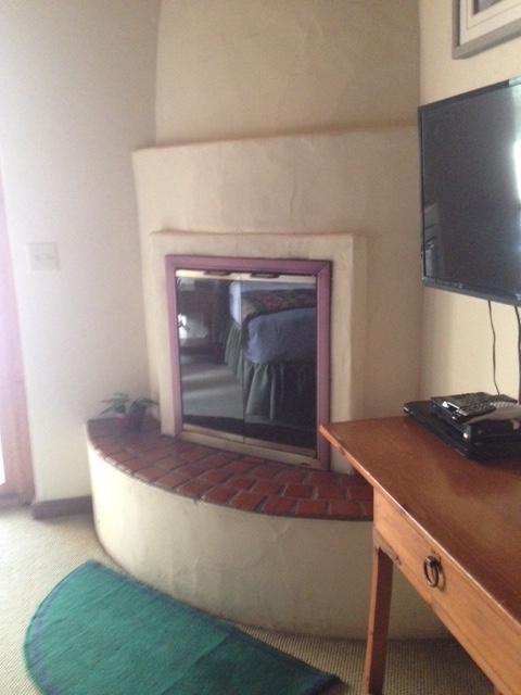 kiva fireplace, master bedroom Junipine Resort Sedona AZ neversaydiebeauty.com