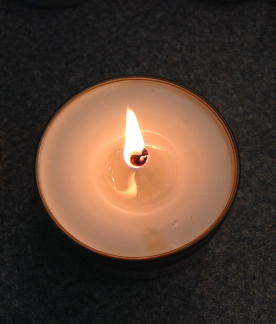 lit MojoSpa candle, burning to create body cream neversaydiebeauty.com
