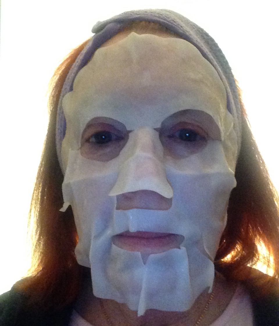 me wearing cotton SK-II Facial Treatment Mask neversaydiebeauty.com