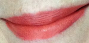 "my lips wearing Youngblood Cosmetics Intimatte Lipstick in ""Flirt"" a peachy coral shade neversaydiebeauty.com @redAllison"