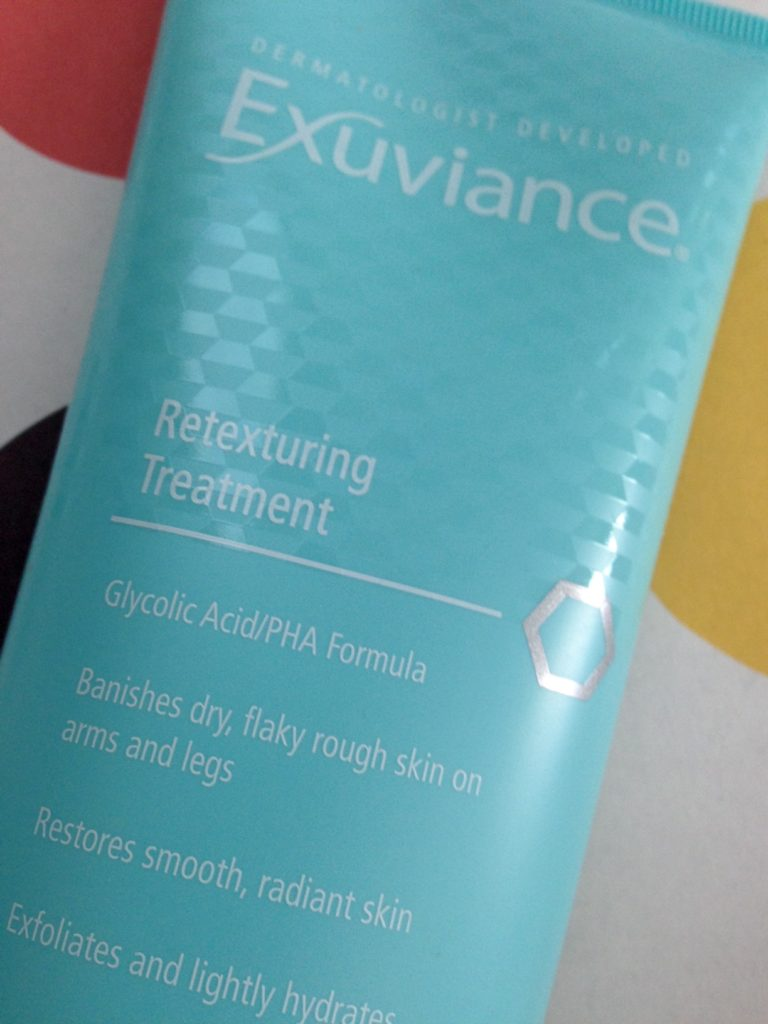 Exuviance Retexturing Treatment, closeup of benefits listed on tube neversaydiebeauty.com