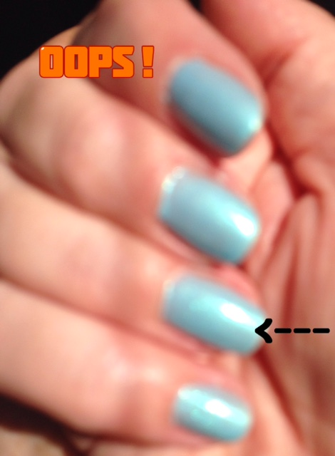 blurry photo that shows the holographic effect of Zoya Nail Polish, shade Payne, an aqua shimmer with deeper turquoise and green holo effects neversaydiebeauty.com