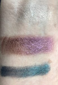 Mirabella Masquerade Eye Lights shadows, swatches: Charade teal, Mystery grape, Gilt champagne gold finger swatches neversaydiebeauty.com