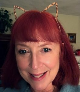 me wearing leopard ears neversaydiebeauty.com