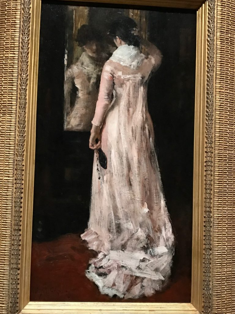 Woman Dressing to Go Out (pink dress), painting by William Merritt Chase at MFA exhibit