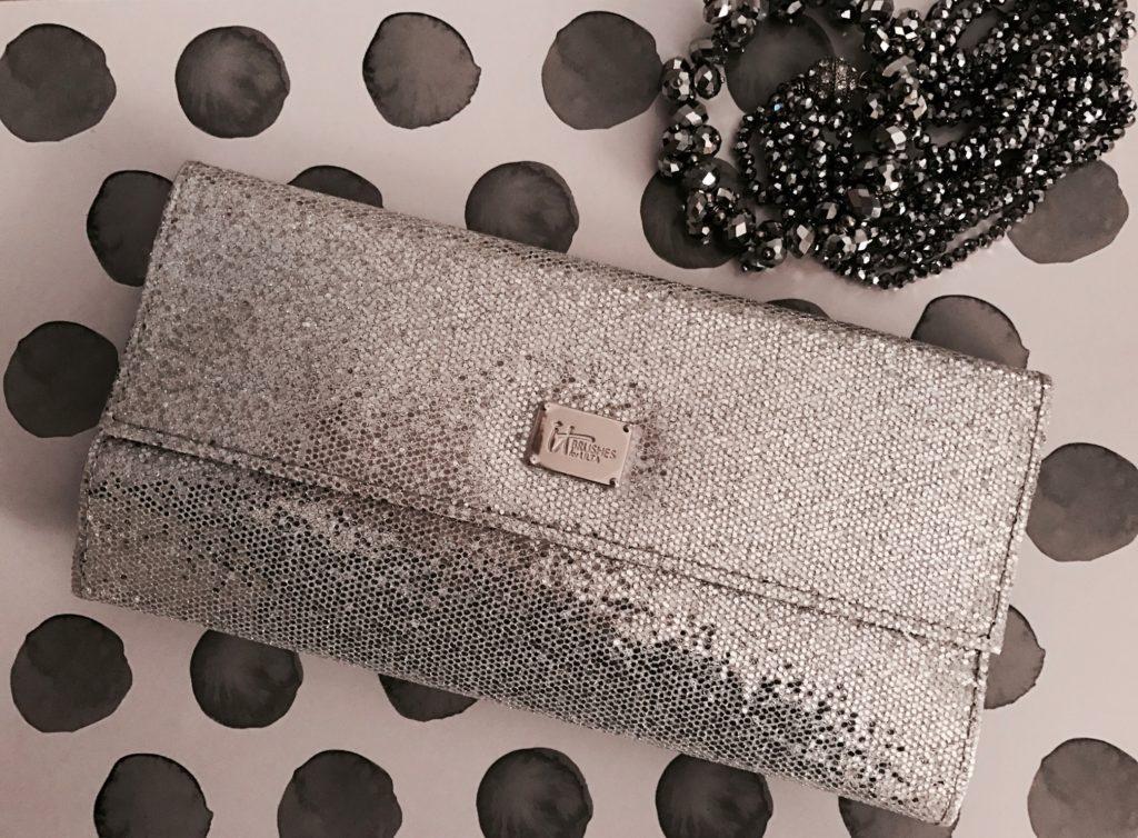 IT Cosmetics for Ulta silver clutch holding All That Glitter makeup brush set, neversaydiebeauty.com