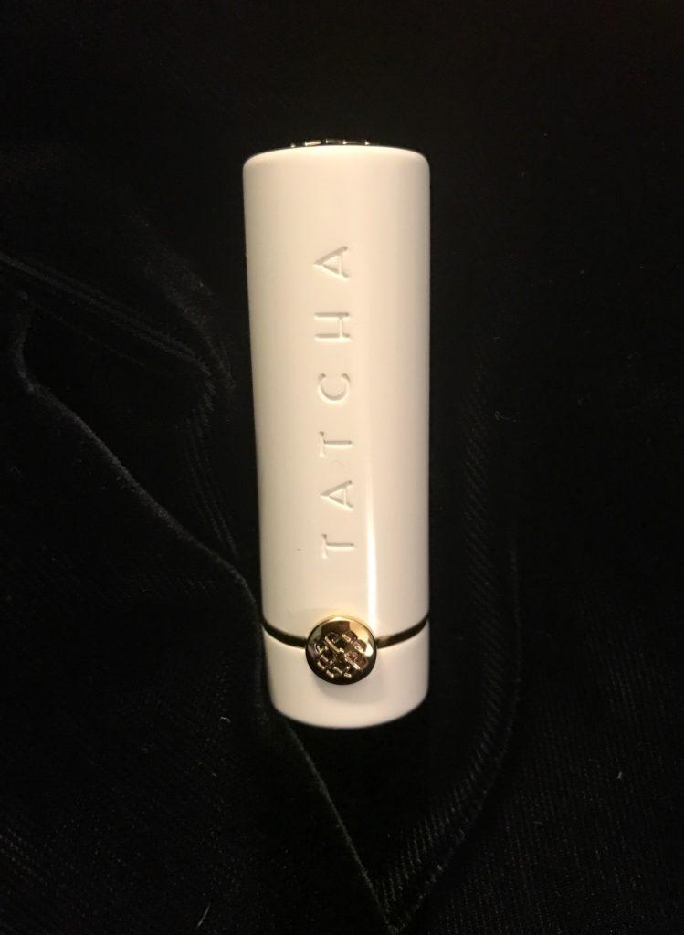 hero shot of TATCHA Sunrise lipstick in white metal case, neversaydiebeauty.com