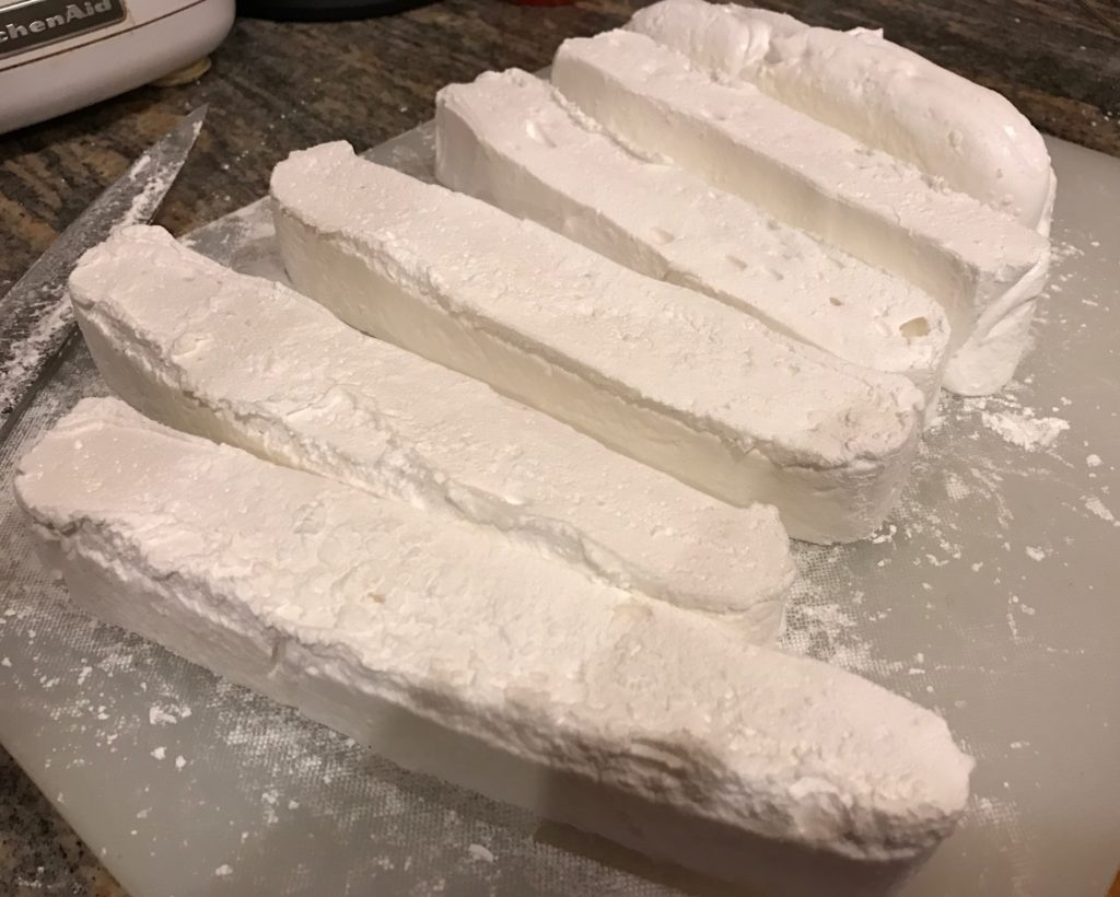 cutting marshmallows into strips, then cubes, neversaydiebeauty.com