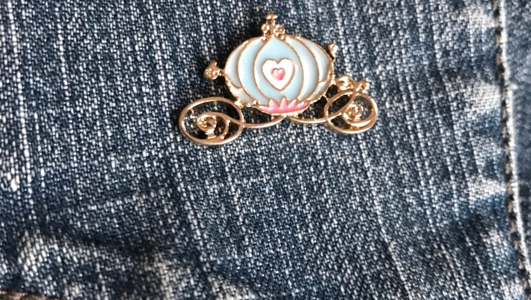 enameled pin of Cinderella's coach from Femme de Bloom, neversaydiebeauty.com