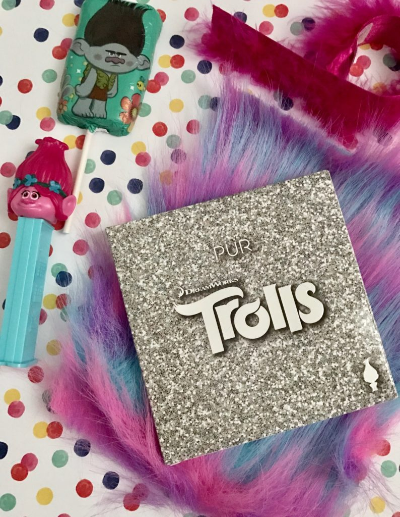 PUR Cosmetics Trolls Shadow Palette in outer packaging wi Poppy Pez dispenser & chocolate lollipop, neversaydiebeauty.com