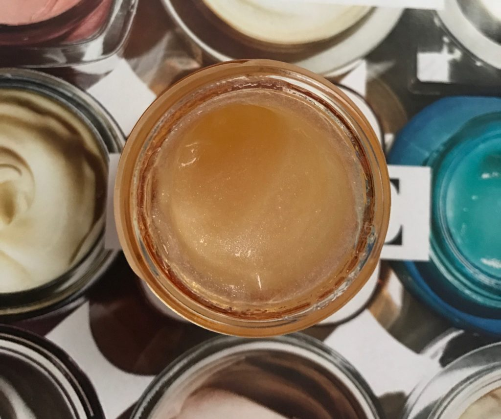 closeup of the golden gel cream of The Body Shop Oils of Life Intensely Revitalizing Eye Cream Gel, neversaydiebeauty.com