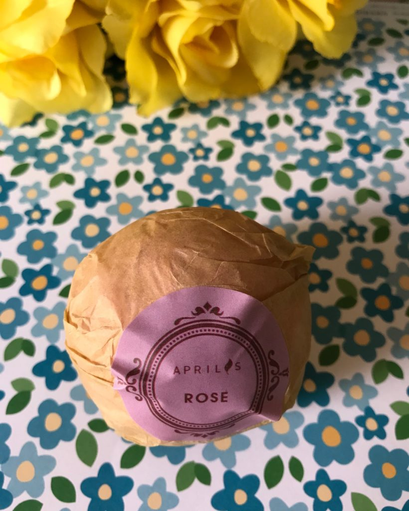 Aprilis rose bath bomb in paper wrapper with identifying label, neversaydiebeauty.com