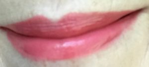 lip swatch of Revlon Ultra HD LipColor in shade Sunset 725, a pinky coral shade, neversaydiebeauty.com