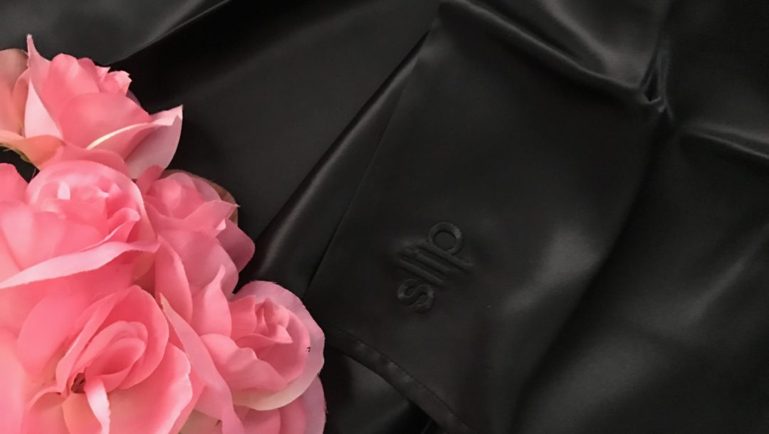 Slip Pure Silk Pillowcase in black silk embossed with the logo, neversaydiebeauty.com