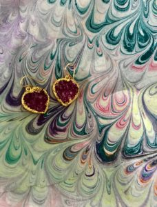 closeup of Uno Alla Volta purple drusy heart earrings and silk water marble scarf, neversaydiebeauty.com