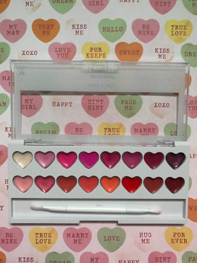 Wet N Wild Perfect Pout Lip Palette, open to show 16 heart-shaped gloss pans & lip brush, neversaydiebeauty.com