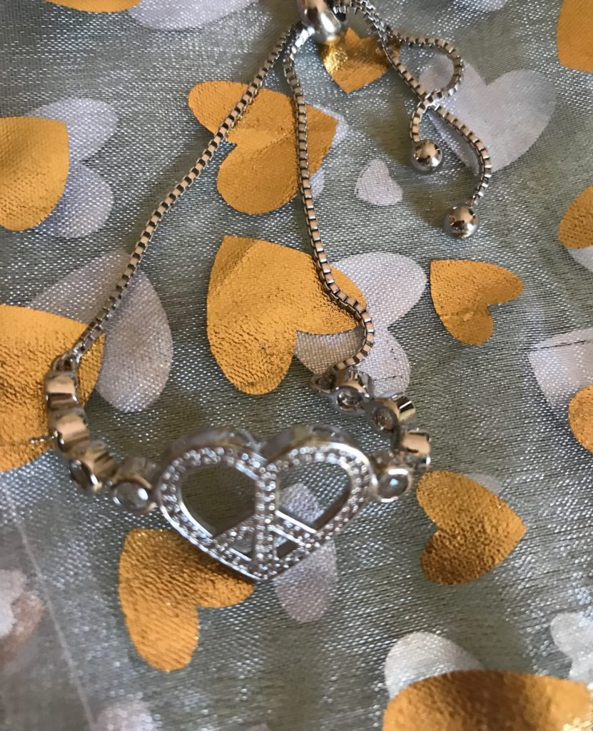 heart-shaped peace sign silver tone bracelet with white topaz, neversaydiebeauty.com
