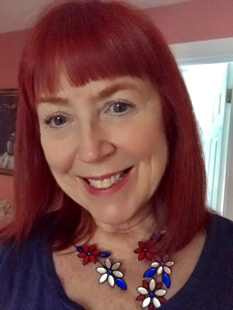 me wearing Hanna's Patriotic Flower Necklace from Uno Alla Volta, neversaydiebeauty.com