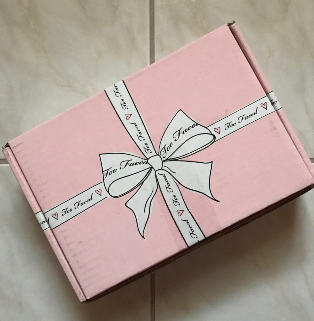 Too Faced pink and ribboned shipping box, neversaydiebeauty.com