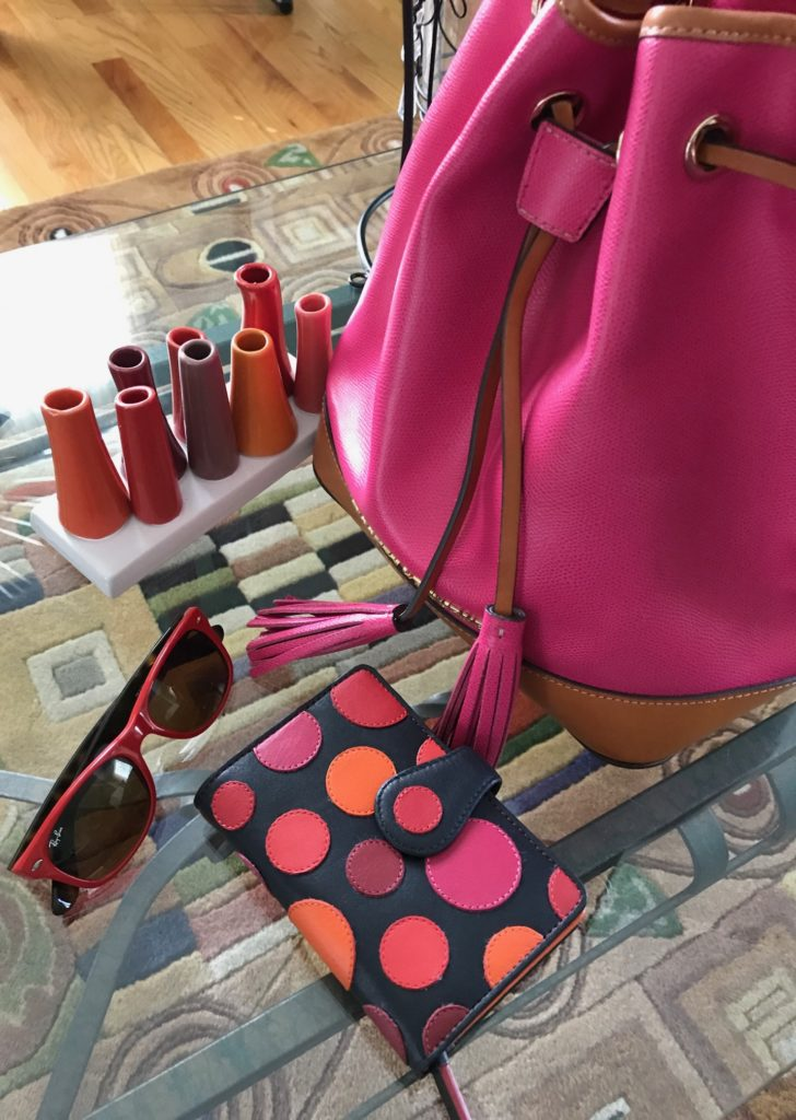 my summer accessories: Visconti polka dot Pluto wallet, Dooney & Burke hot pink drawstring bag, red & tortoise Ray Ban sunglasses, neversaydiebeauty.com