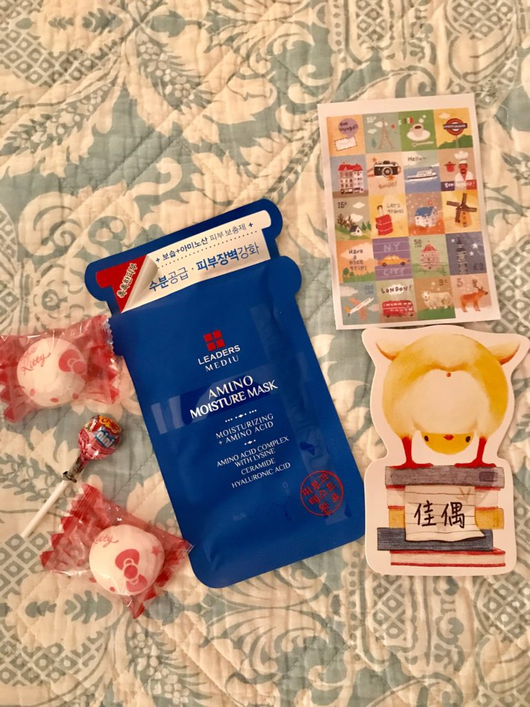 candy, stickers and facial mask thank you gifts from Beautius.com, neversaydiebeauty.com
