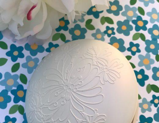 closeup of the Paul & Joe Gel Foundation white plastic compact, neversaydiebeauty.com