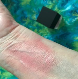 swatch rubbed in of NARS Liquid Blush in Orgasm, neversaydiebeauty.com