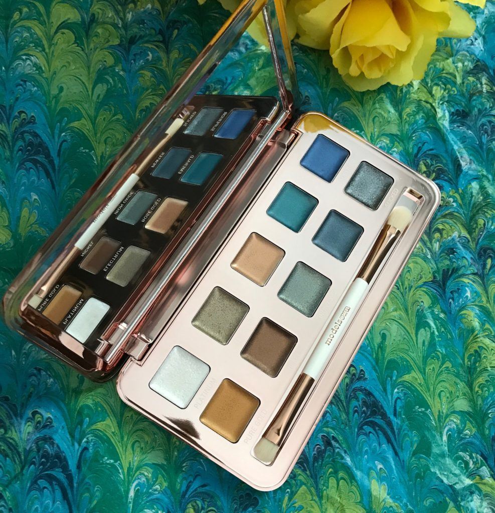 ModelsOwn Colour Chrome eyeshadow palette, open to show mirror, brush, 10 cream shadows and their names, neversaydiebeauty.com