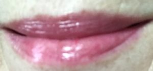 lip swatch of Sweet Cherry, Revlon Kiss Balm, neversaydiebeauty.com