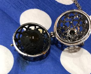 essential oil dropped onto a lava ball inside an aromatherapy necklace, neversaydiebeauty.com