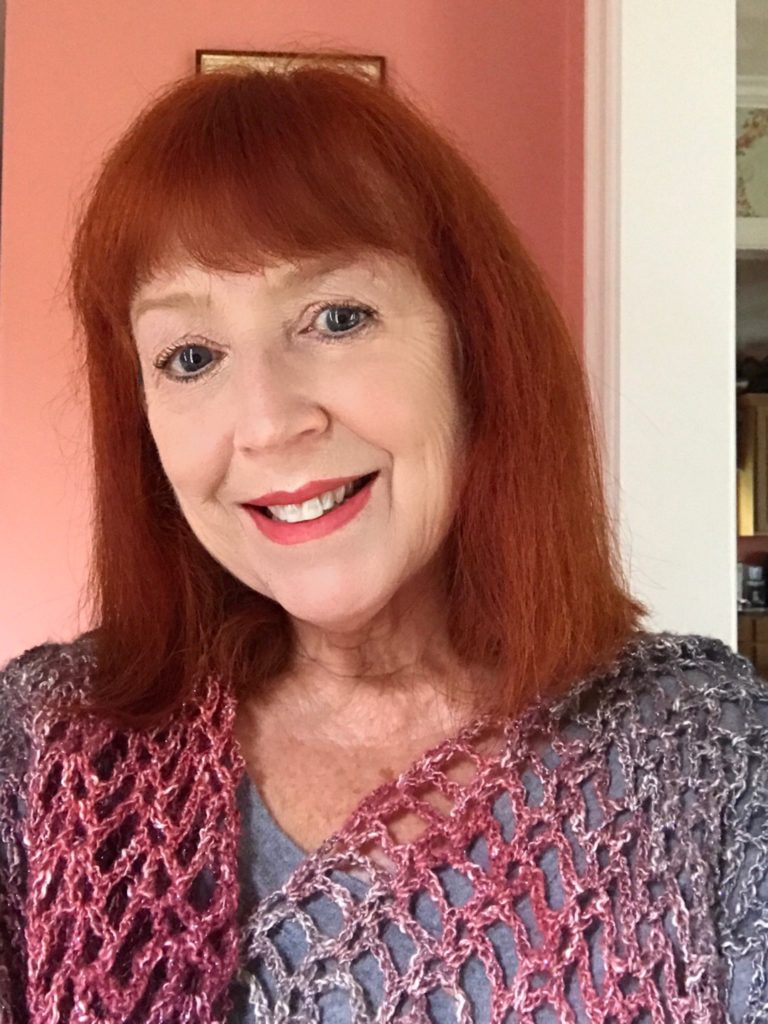 me wearing a Sparkle shawl that I crocheted, neversaydiebeauty.com