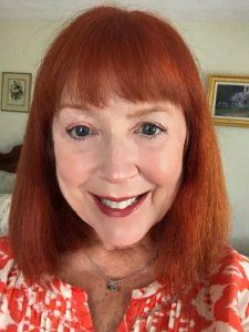 me wearing orange top & makeup, neversaydiebeauty.com