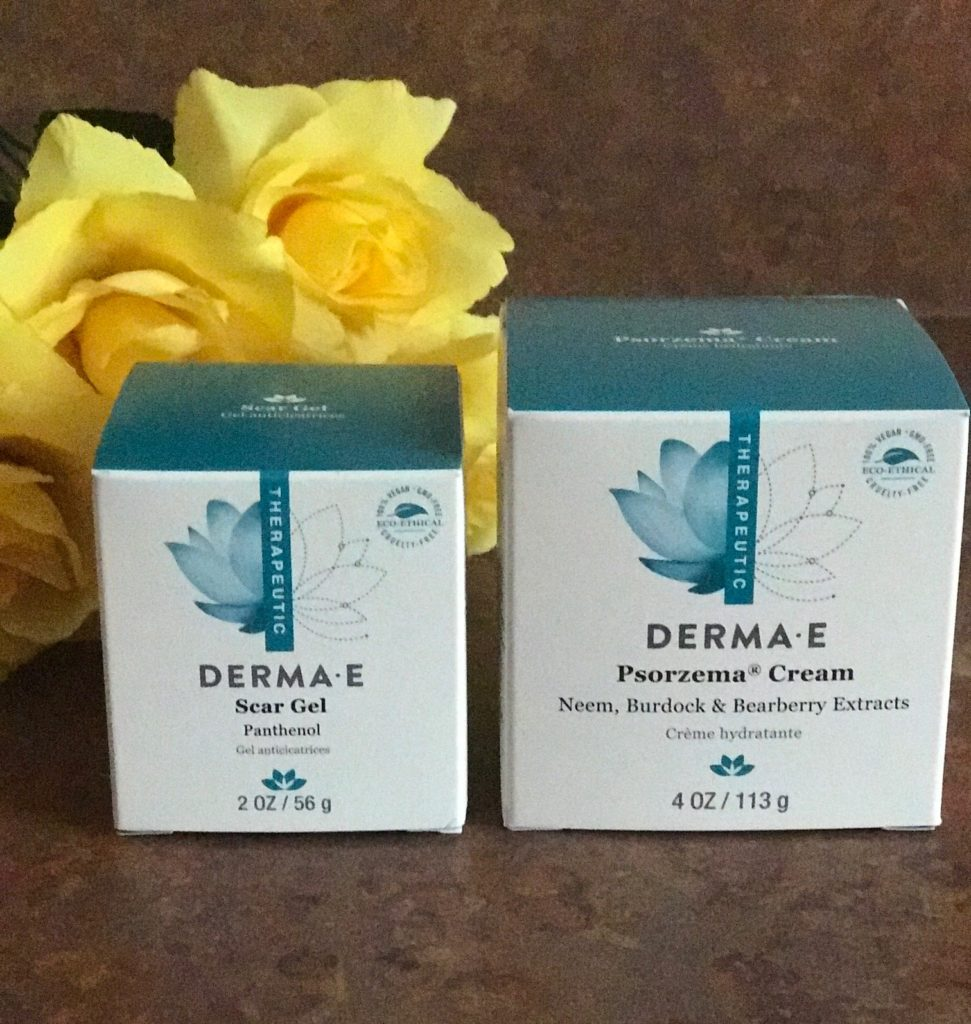 Derma E Scar Gel and Psorzema Cream in their outer packaging, neversaydiebeauty.com