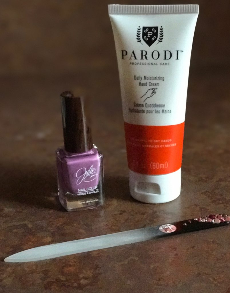 Parodi Daily Moisturizing Hand Cream tube with nail polish and file, neversaydiebeauty.com