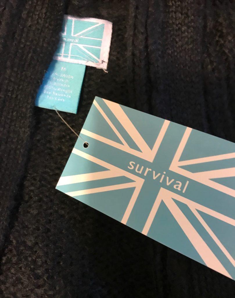 Survival clothing brand logo tag, neversaydiebeauty.com