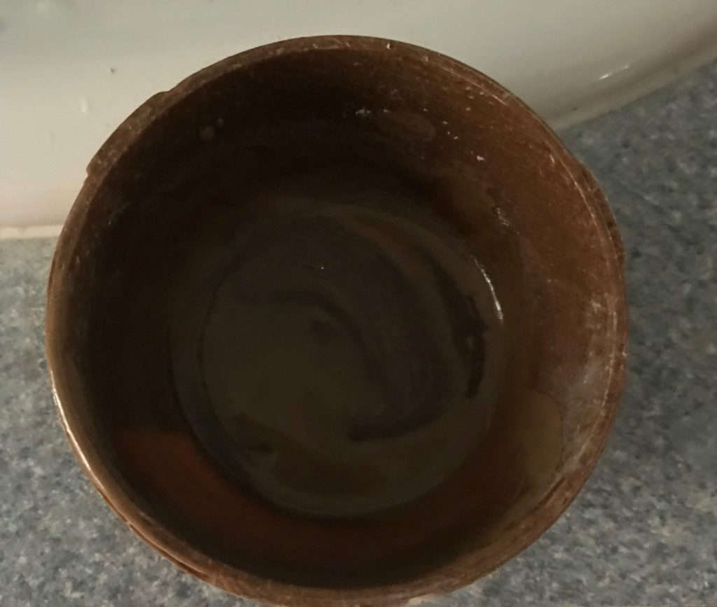 Clay Mask from Surya Brasil mixed in the container, neversaydiebeauty.com