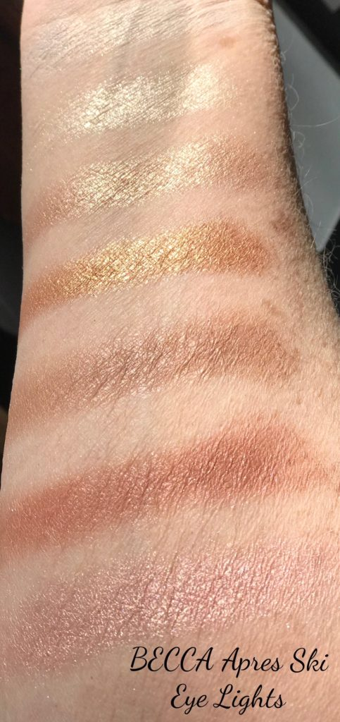 swatches of BECCA Apres Ski Eye Lights shadow palette in the sunlight, neversaydiebeauty.com