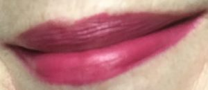 my lips wearing RK by KISS Cream.li.cious Triple Butter Matte Lip Cream in the raspberry colored shade: Berry In Love, neversaydiebeauty.com