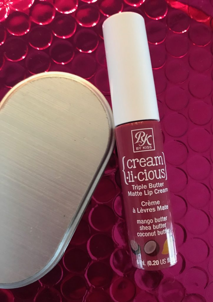 a tube of RK by KISS Cream.li.cious Triple Butter Matte Lip Cream in Berry In Love, neversaydiebeauty.com