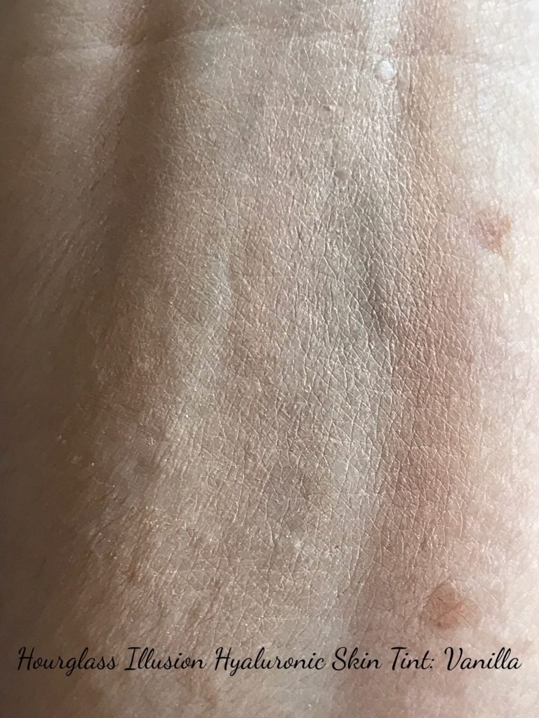 lightly blended swatch of Hourglass Illusion Hyaluronic Skin Tint, shade Vanilla, neversaydiebeauty.com