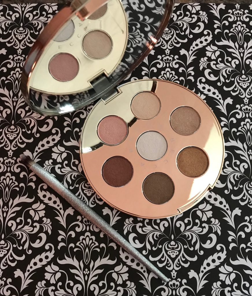the BECCA Apres Ski Eye Lights shadow palette open to show shades and mirror, neversaydiebeauty.com