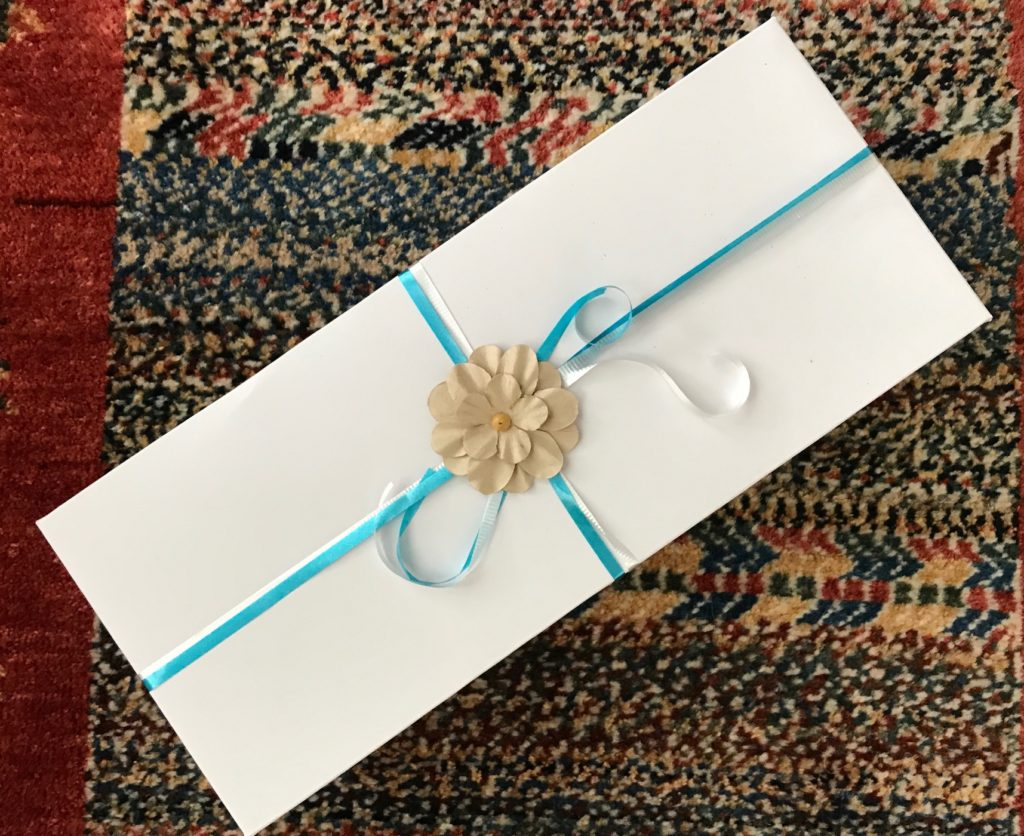 wrapped package from Bloom Mineral Beauty, neversaydiebeauty.com